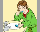 Coloring page Little boy brushing his teeth painted byAnia